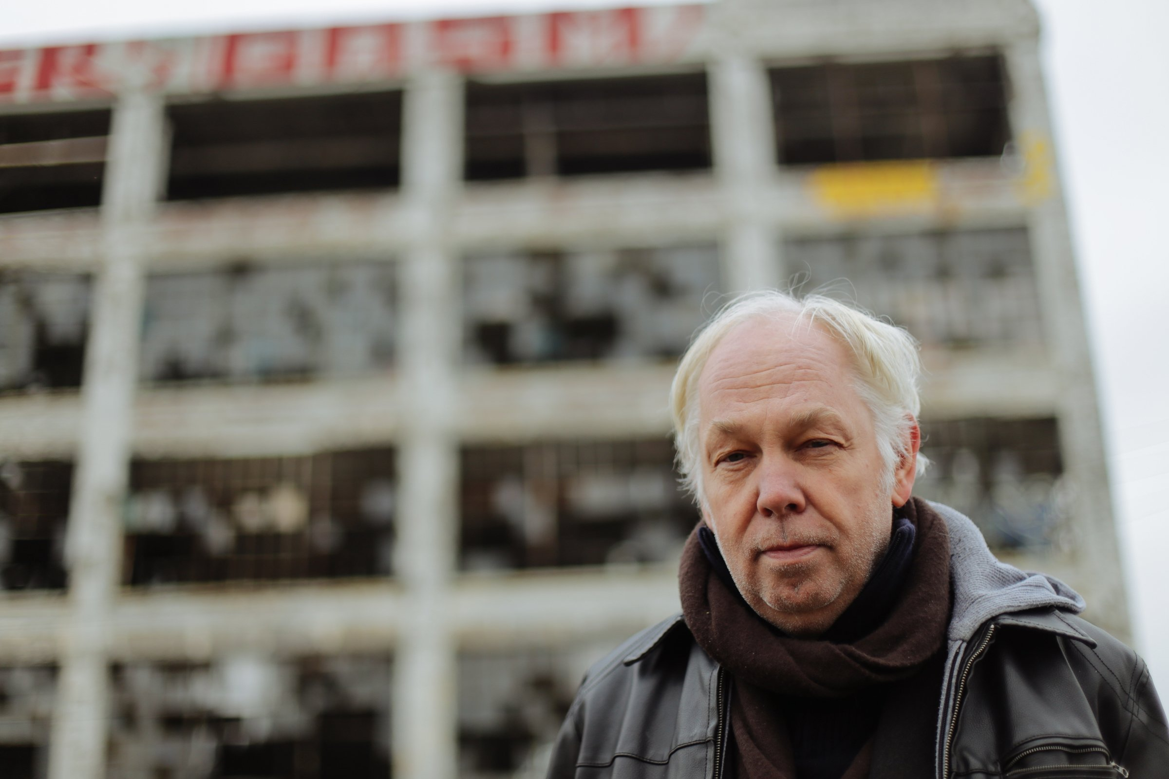 World-renowned Berlin club owner Dimitri Hegemann poses for a photo outside the vacant Fisher Body Plant No. 21 in Detroit on Wednesday November 26, 2014. Hegemann has proposed converting the building into a techno club and community center.